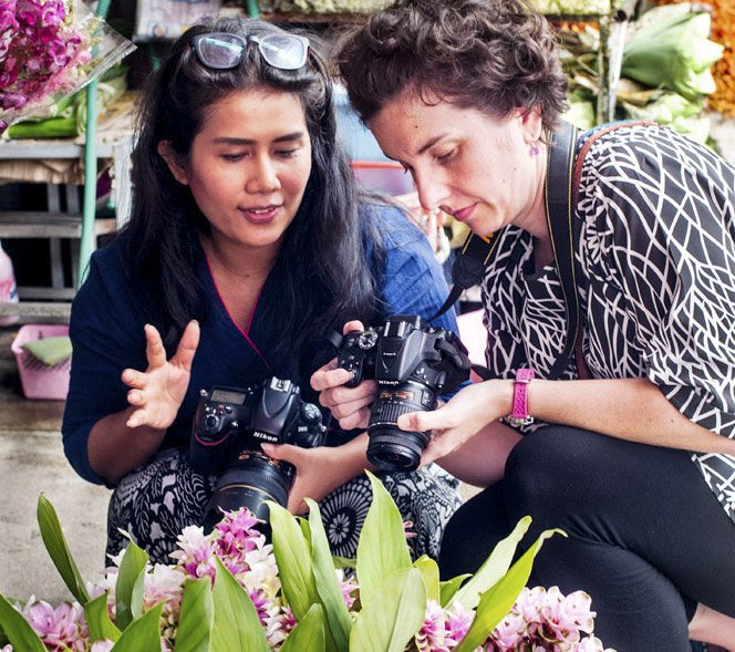 Women teaching and learning photography on a Chiang Mai Photo Workshop