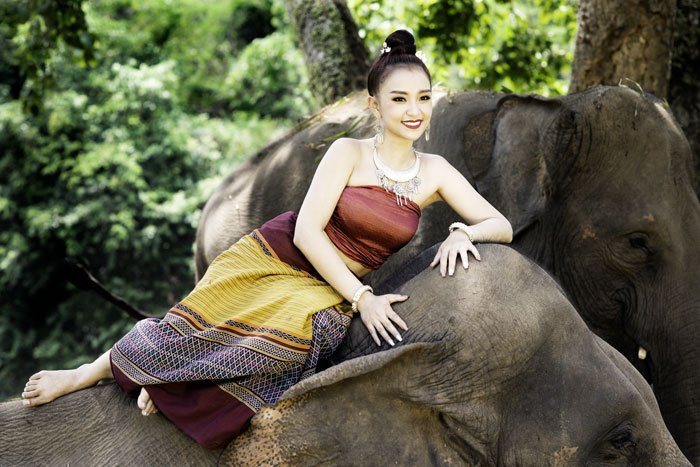 Thai Model Resting on an Elephant during a 5 day photography workshop