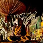 Monk  in a cave on Doi Inthanon, Thailand